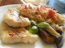 Alaskan fish fillets with tomato & garlic rice